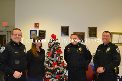 Damariscotta Police Officer James Dotson (left), with new administrative assistant Joanna Kenefick, Chief Ron Young, and Officer Erick Halpin stand together after being introduced to the board of selectmen, Dec. 17. (Michelle Switzer photo)
