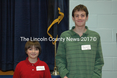 Lincoln County spelling bee champion Taylor Holmes (right) poses with runner-up Christopher Burrow after the competition at Great Salt Bay Community School in Damariscotta Feb. 11. (J.W. Oliver photo)