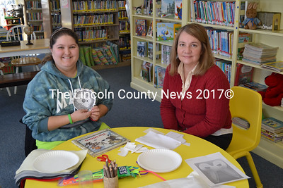 Wiscasset Public Library's new children's librarian Natalie Castonia (right) with library volunteer Sam Davison. (Kathy  Onorato photo)