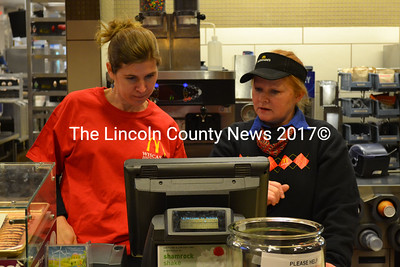 Wiscasset High School social studies teacher, Kelley Duffy (left) pays close attention to the instruction of Cindy Chapman, of McDonalds, teaching her how to place an order. (Kathy Onorato photo)