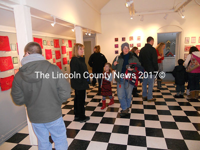 Tidewater Gallery guests mingle among the inspirational artworks of their young artist/students. (K. Fletcher photo)