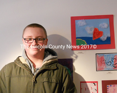 """Medomak Middle School artist Andrew Beaucage with his """"Love in the Air"""" (top, right) made of air-dried clay, pastel and feathers. (K. Fletcher photo)"""