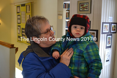 Retired children's librarian Judy Flanagan brings her 15-month old grandson Aiden for a visit to the Wiscasset Public Library Feb. 6. (Kathy Onorato photo)