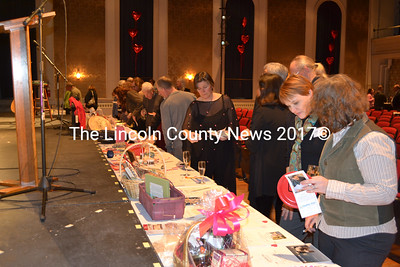 Potential bidders peruse a display of silent items during Healthy Kids' 13th Annual ChocolateFest Feb. 8