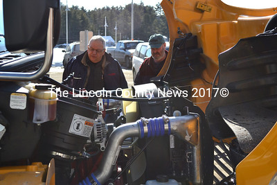 Scott Higgins (right), the head school bus driver for Jefferson Village School, and George Cressey, of W.C. Cressey & Son, take a look under the hood of the school's new Thomas school bus. (D. Lobkowicz photo)