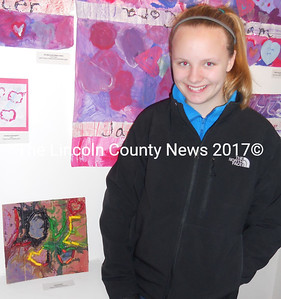 """Waldoboro Middle School sixth-grader Chloe Bosson created """"Colorful Love"""" out of melted crayon and watercolor. (K. Fletcher photo)"""