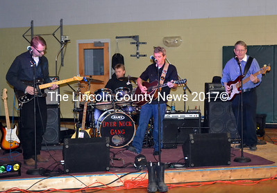 A community dance featured The Dyer Neck Gang at the Wiscasset Community Center on  Feb. 1. Members of the band includes (from left) Rod Morton, lead guitar; Garry Blackman, Jr., drummer; Joe Dalton, guitar/ vocals; and Sherwood Olin, bass  guitar. (Kathy Onorato photo)