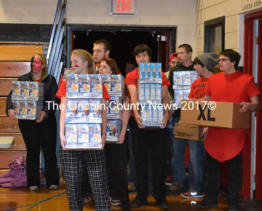 Wiscasset High School seniors carry a load of food donated by Big Al's. (Kathy Onorato photo)