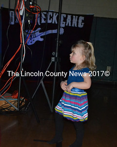 Little Isla Bickford, daughter of Kassandra and Tony Bickfore of Wiscasset, dances to the music of the Dyer Neck Gang. (Kathy Onorato photo)