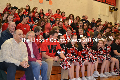 Wiscasset selectmen Ed Polewarczyk (front left) and Gretchen Burleigh Johnson of the Feed Our Scholars committee join WGME's Jeff Peterson (with mic) at the Wiscasset High School pep rally Jan. 31. (Kathy Onorato photo)