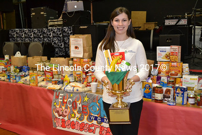 Katy Robinson of Maine Credit Unions displays the Spirit Cup Wiscasset High School hopes to win by collecting the most food in the second round of WGME's School Spirit Challenge. (Kathy Onorato photo)