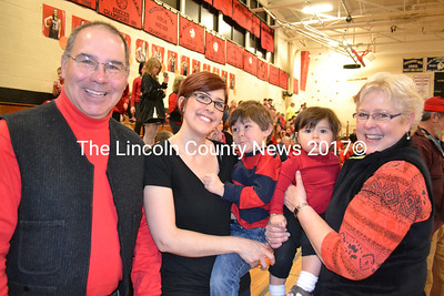 Three generations of Wiscasset High School supporters take part in Friday's pep rally. From left to right, David Sawyer, his daughter Jillian Burke holding grandson Ephriam and David's wife Sheila with granddaugher Petra. (Kathy Onorato photo)