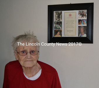 Frances Miller, 92, hangs photos of the Royal Family in her Whitefield home. (Kathy Onorato photo)