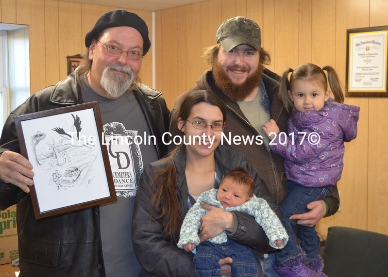 Inspired by the roadside birth of Ayden Bailey Feb. 20, famed Newcastle artist and longtime LCN cartoonist Glenn Chadbourne memorialized the event in a cartoon which was printed in LCN Feb. 27. Chadbourne presented his orginal drawing of the cartoon to the Taylor-Bailey family last week. Shown from left to right, Chadbourne, Theresa Taylor with Aydan, Mark Bailey, and sister Lilly Bailey. (Sherwood Olin photo)