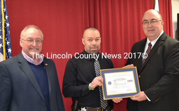 Lincoln County Sheriff's Office supervisor Lt. Michael Murphy (right) is recognized for his support of military service March 14, by Dennis Wellman, executive director of Employer Support of The Guard and Reserve, and Lincoln County Detective Scott Hayden (center). (Kathy Onorato photo)