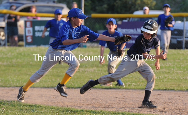 Dawson Wall chases down and tags out Oceanside's Noah Ames in the fifth inning. (Paula Roberts photo)