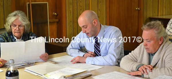 Edgecomb officials discuss the fiscal year 2013 audit. From left, Town Clerk Claudia Coffin, auditor Fred Brewer and bookkeeper Fran Mague. (Kathy Onorato photo)