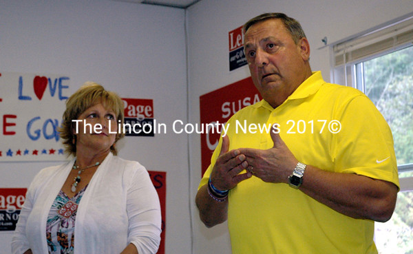 Maine Gov. Paul LePage speaks at an open house at the Midcoast Freedom '14 Office in Damariscotta Wednesday, Aug. 20. First Lady Ann LePage looks 