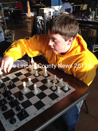 Medomak Middle School chess player Noah Munn makes a move during the state tournament at UMO.