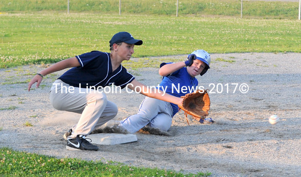 Nate Howard steals third for Vassalboro as Jefferson's Damien Doe stretches for the low throw. (Paula Roberts photo)