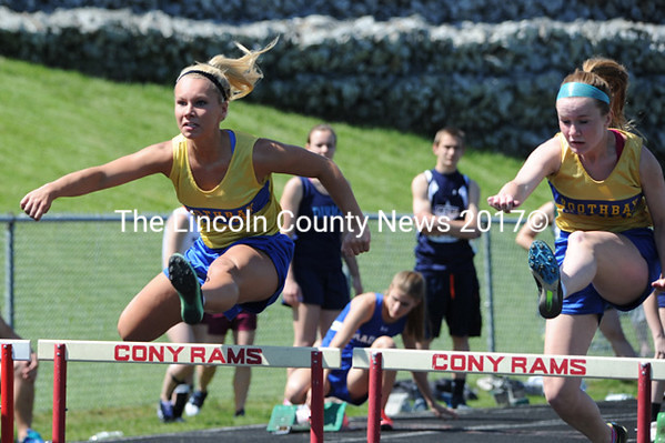 Morgan Crocker and Sinead Miller compete in the 100m hurdles for Boothbay at the MVC championships. (Paula Roberts photo)