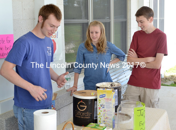 Jefferson Fire & Rescue Explorer Scouts (from left), Josh Stone, 16, Madyson Geboski, 14, and Tristan Geboski, 16, helped dish out ice cream provided by Jefferson Scoop. (D. Lobkowicz photo)