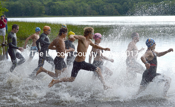 Swimmers are off at the start of the Medomak Valley Triathlon. (Caleb Farrin photo)