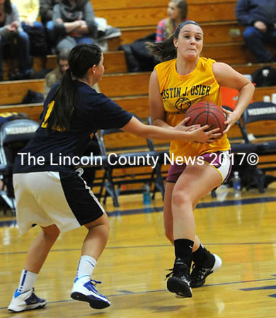 Lindsay Ranquist pulls the ball away from Alanna Vose.