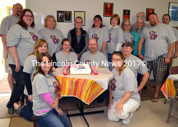 The Lincoln County Communications team: Front row, from left, Melissa Temple, Teresa Grenie; second row, from left, Nicole Merriman, Sarah Sherman, Mark Creamer, Casey Stevens; back row, from left, Rob Bickford, Emily Snowman, Pam Reed, Kathy Blagdon, Sonia Lilly, Tanya Bailey, Bobbie Robinson, Carol Blodgett, Commissioner Bill Blodgett (partially hidden), Josiah Winchenbach, and Tod Hartung. (Kathy Onorato photo)