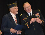 Maine Bureau of Veterans' Services Director Peter Ogden (right) presents a certificate of appreciation to World War II Veteran William Collins   during the D-Day remembrance at Wiscasset High School, Friday, June 6. Collins is a veteran of the invasion of Normandy on June 6, 1944. (Charlotte Boynton photo)