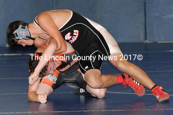 Lincoln Academy wrestler Keegan Dunican battles Winslow's Andrew Beckwith in the pigtails in the Westlake Tournament. (Paula Roberts photo)