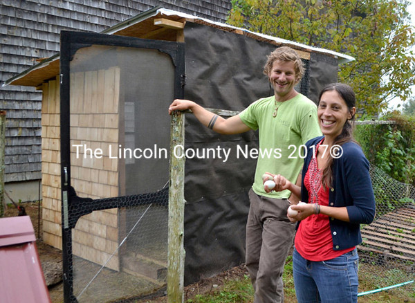 Recently relocated to Waldoboro, farmers Jon McKee and Christelle Munnelly stand near a chicken coop McKee built. (D. Lobkowicz photo)