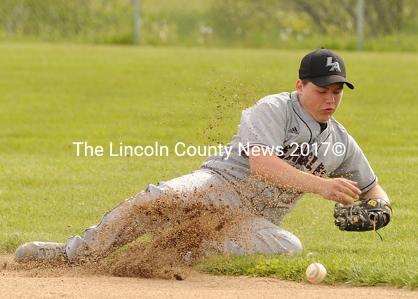 Lincoln Academy second baseman Tyler Stevens dives to keep the ball in the infield. (Paula Roberts photo)