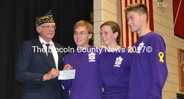 The Wiscasset High School Student Council presents a $200 check to American Legion Post Cmdr. William Cossette for the Post's effort to place   American flags on utility poles throughout Wiscasset. From left: Cossette, Council President-elect Ridge Barnes, Vice President Briana Goud, and President Logan Grover.   (Charlotte Boynton photo)