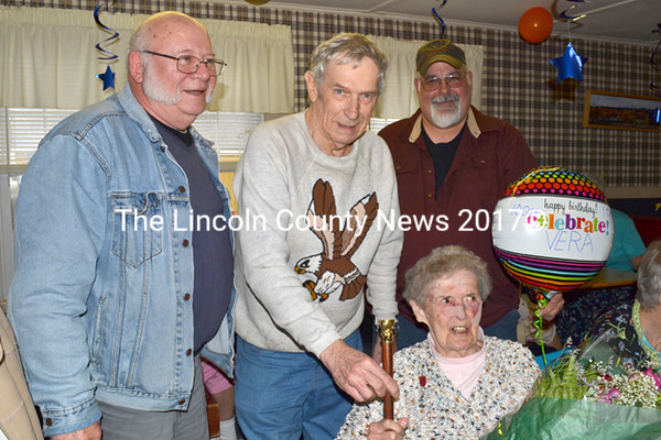 The Westport Island Board of Selectmen honored the town's oldest citizen. Vera Cleave, with the presentation of a dozen roses and the Boston Post Cane at her 100th birthday celebration, May 4. Shown left to right, selectmen Gerald Bodmer, George Richardson, and Ross Norton. (Charlotte Boynton photo)