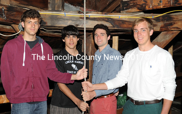 Lincoln Academy's 4x800 relay team celebrates their KVAC championship by ringing the school bell Monday morning. Pictured are Nick Smelcer, Alex Organ, Julian Frink, and Seward Matel. (Paula Roberts photo)