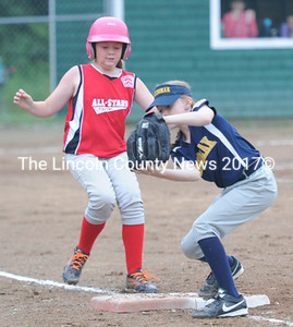 Medomak first baseman Autumn Ripley makes the catch to pick up the out on Olivia Brown. (Paula Roberts photo)