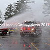 The Damariscotta Fire Department's new Engine 3 roars through the waters at a wet-down ceremony Saturday, Dec. 6. A wet-down ceremony is a tradition in fire departments preparing new fire apparatus for service. (Abigail Adams photo)
