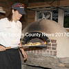 Lara DePietro removes a pizza from the woodburning over at Squire Tarbox Inn and Restaurant on Westport Island.