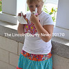 Emily Sprague, 7, has a lick of Moose Tracks ice cream at the Jefferson Public Library's 30th anniversary celebration Aug. 23. (D. Lobkowicz photo)