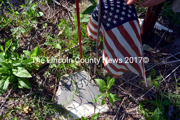Now that the land has been cleared, the Newcombe family of Whitefield are finding cemetery artifacts. This piece of marble is likely part of a head stone. (Kathy Onorato photo)