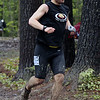 Medomak Valley graduate Zak Wieluns runs through the mud at a recent race.