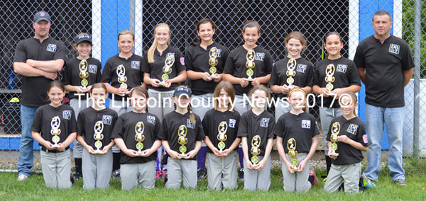 Damariscotta Bank & Trust won the 2014 Lincoln Little League softball championships. Team members are (front from left) Olivia Stiles, Liza Cheney, McKenna Fitzpatrick, Addy Brinkler, Page Olson, Taylor Fink, Payson Kayler, and Emma Scott; (back) coach Adam Gamage, Jewel Farrin, Sophie Gamage, Halle Hallowell, Jayden Gilbert, Jenna Gilbert, Anna Lee Presley, Emily Kelsey, and coach Kurt Hallowell.
