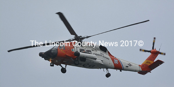 A helicopter out of U.S. Coast Guard Air Station Cape Cod searches for a sailboat in distress off Pemaquid Point at 8:50 a.m., Friday, Jan. 17. The search has been
