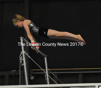 Leah Wilcox casts off the high bar.