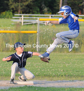 Joel Pitcher tags out Vassalboro's Caden Turcotte who attempted to jump over the tag. Turcotte was trying to stretch a single into a double and was thrown out by right fielder Gavin Pinkham. (Paula Roberts photo)