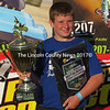 Zachary Farrin with his winning trophy and second place plaque won at at Maine's biggest Motorcross event, the MX 207, held in Lyman July 20.  (Photo courtesy Farrin family)