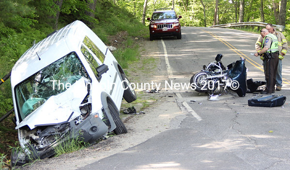 Lincoln County Sheriff's Deputy First Class Mark Bridgham and Alna Fire Chief Mike Trask examine the scene of a motorcycle-van collision in Alna, Sunday, June 8. (Sherwood Olin photo)