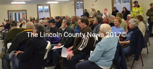 There was standing room only at Dresden's Powalborough Hall Tuesday evening for a special town meeting. About 90 residents took over an hour to decide a single article, voting to oppose selectmen's recommendations to change the positions in the town office. (Charlotte Boynton photo)