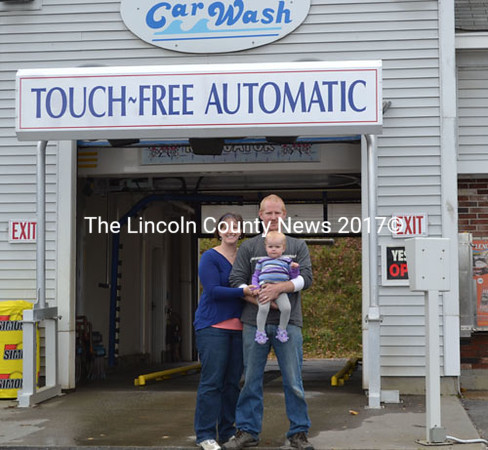 Terri Herald, Darick Herald, and daughter Charlotte stand in front of Coastal Car Wash in Damariscotta, Oct. 26. The couple bought the business   Sept. 15. (Michelle Switzer photo)